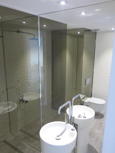 Oglinda la comanda pentru baie
