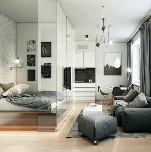 dormitor si living separate prin perete din sticla